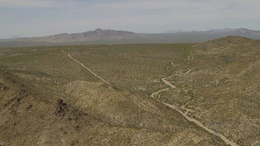 4K stock footage aerial video of hills and open Mojave Desert on the border of Nevada and California Aerial Stock Footage | FG0001_000030