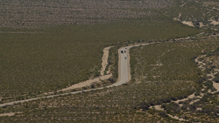 4K stock footage aerial video of bus and cars traveling on a Mojave Desert highway in Laughlin, Nevada Aerial Stock Footage | FG0001_000033