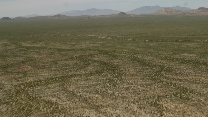 Fly over a wide Mojave Desert landscape in San Bernardino County, California Aerial Stock Footage | FG0001_000039