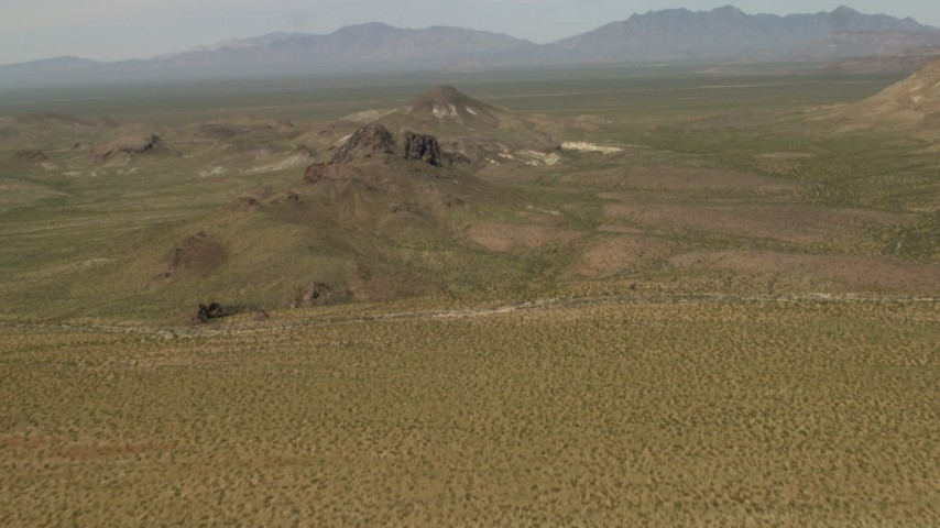 4K stock footage aerial video fly over Mojave Desert hills in San Bernardino County, California Aerial Stock Footage | FG0001_000041