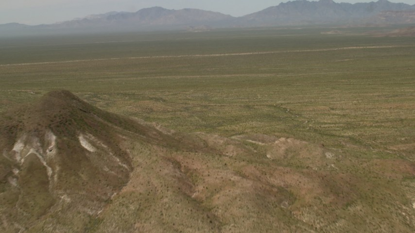 4K stock footage aerial video fly over hills and open Mojave Desert in San Bernardino County, California Aerial Stock Footage | FG0001_000042