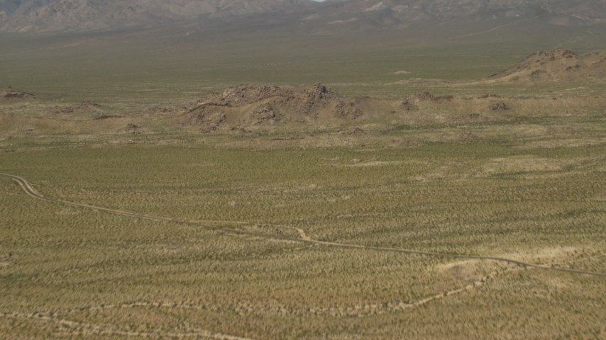 4K stock footage aerial video fly over Mojave Desert hills in San Bernardino County, California Aerial Stock Footage | FG0001_000046