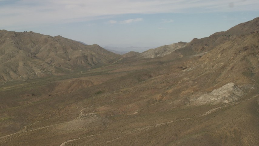 4K stock footage aerial video fly over mountains in the Mojave Desert in San Bernardino County, California Aerial Stock Footage | FG0001_000048