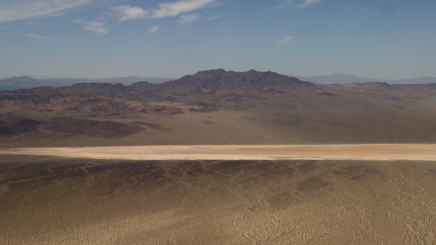 A dry lake near Mojave Desert mountains in San Bernardino County, California Aerial Stock Footage FG0001_000059