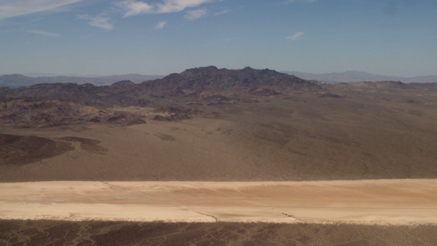 A dry lake and Mojave Desert mountains in San Bernardino County, California Aerial Stock Footage | FG0001_000062