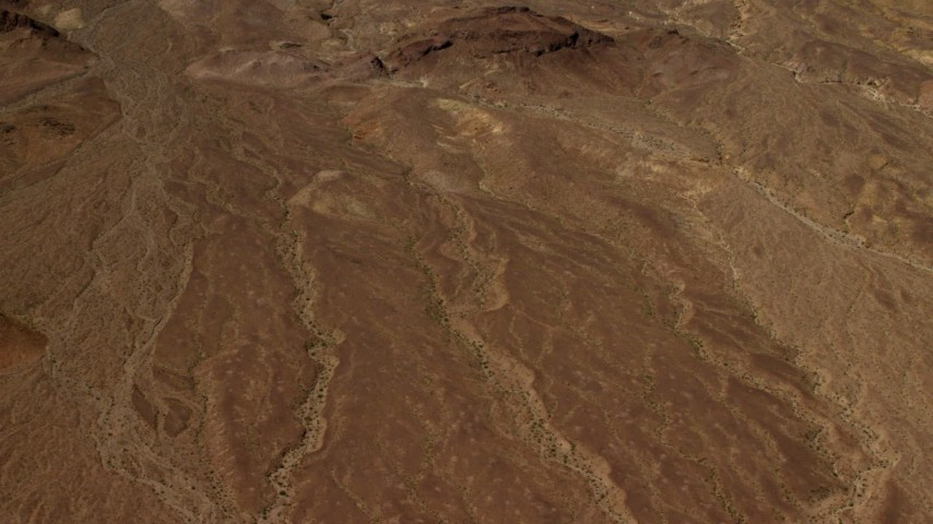 4K stock footage aerial video tilt from a bird's eye view of a Mojave Desert plain to hills in San Bernardino County, California Aerial Stock Footage | FG0001_000076