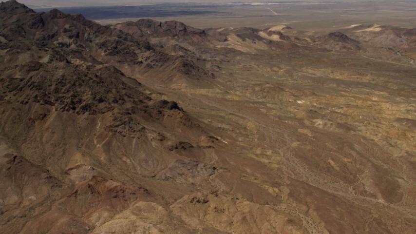 Tilt from Mojave Desert mountains to reveal Pisgah Crater in San Bernardino County, California Aerial Stock Footage   FG0001_000078