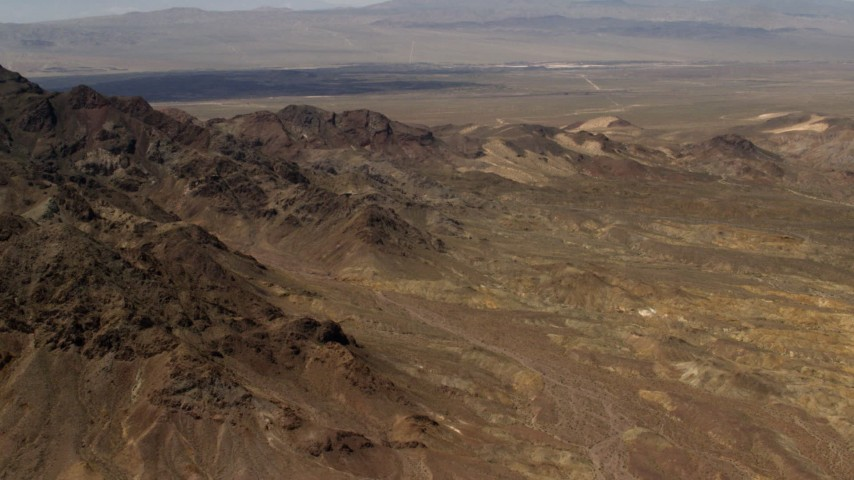 The Pisgah Crater behind rugged Mojave Desert mountains in San Bernardino County, California Aerial Stock Footage | FG0001_000079