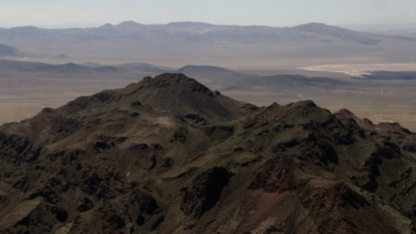 Rugged summit of a Mojave Desert mountain in San Bernardino County, California Aerial Stock Footage FG0001_000082