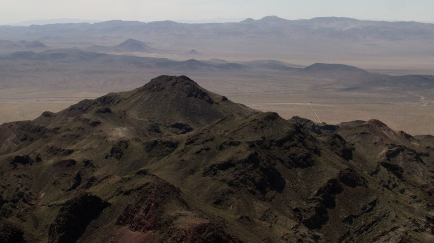 4K stock footage aerial video top of a rugged Mojave Desert mountain in San Bernardino County, California Aerial Stock Footage | FG0001_000083