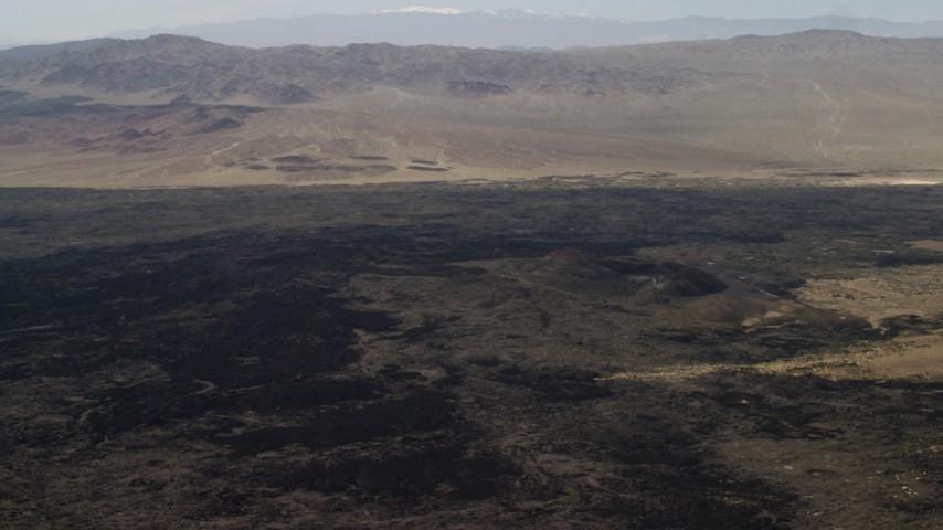 Pan across the lava fields around Pisgah Crater in Mojave Desert, San Bernardino County, California Aerial Stock Footage | FG0001_000087