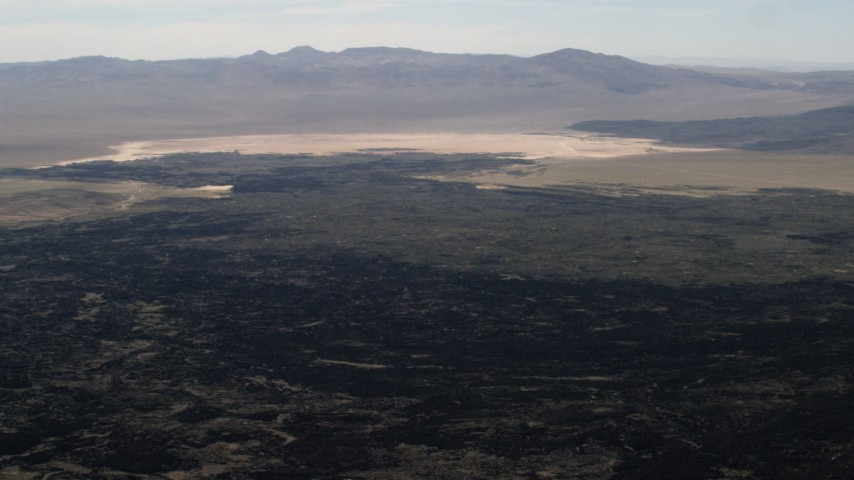 4K stock footage aerial video pan across the lava fields of the Pisgah Crater in the Mojave Desert, San Bernardino County, California Aerial Stock Footage | FG0001_000089
