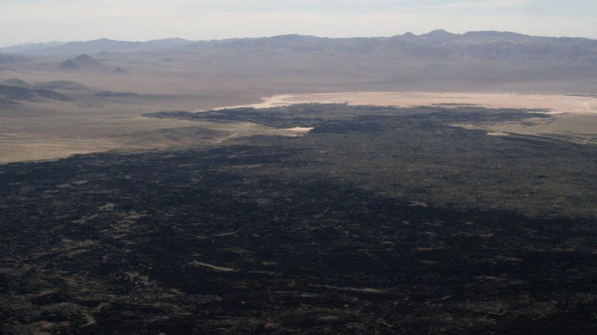 The lava fields of the Pisgah Crater in the Mojave Desert, San Bernardino County, California Aerial Stock Footage | FG0001_000090