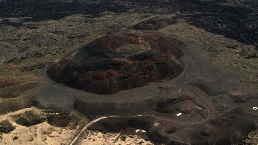 Reverse view of the Pisgah Crater cinder cone in the Mojave Desert, San Bernardino County, California Aerial Stock Footage | FG0001_000093