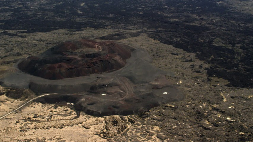 4K stock footage aerial video fly away from the Pisgah Crater cinder cone and lava field in the Mojave Desert, San Bernardino County, California Aerial Stock Footage   FG0001_000094