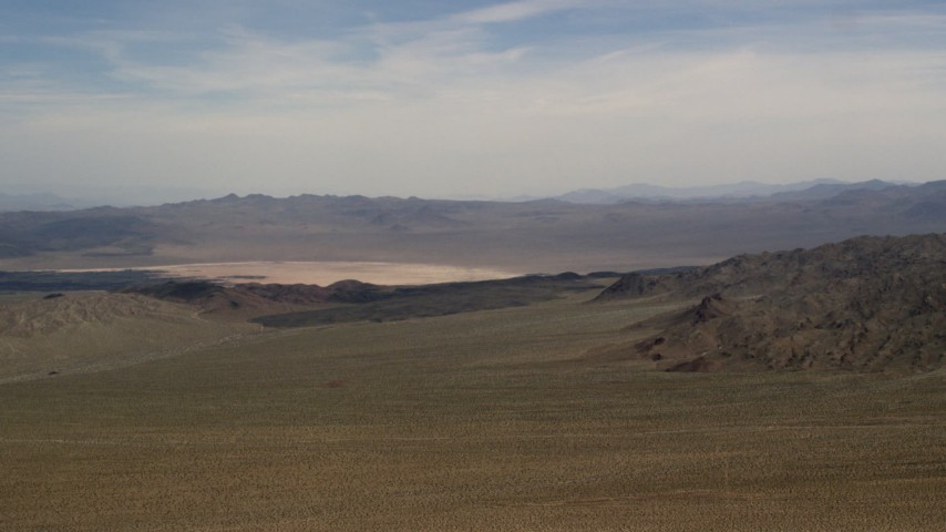 A dry lake and mountains in the Mojave Desert, San Bernardino County, California Aerial Stock Footage   FG0001_000097
