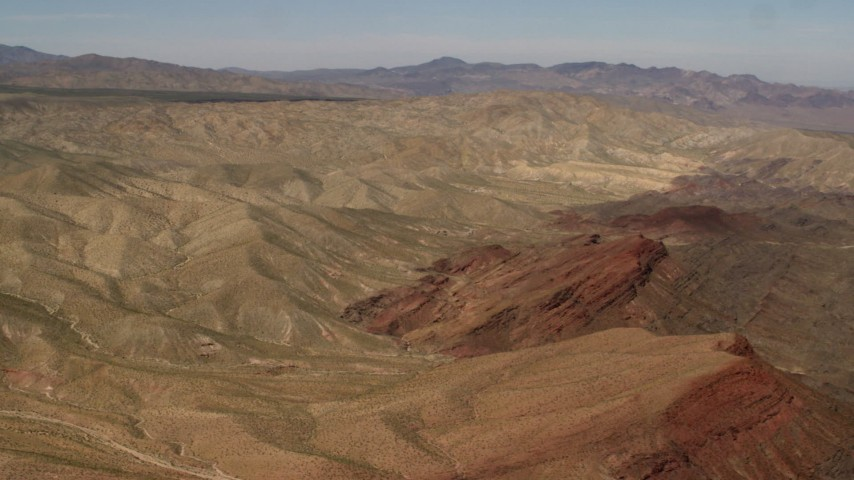 4K stock footage aerial video of passing the Rodman Mountains and colorful striations in the Mojave Desert, San Bernardino County, California Aerial Stock Footage | FG0001_000099