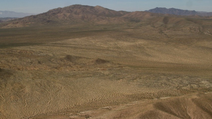 4K stock footage aerial video pan across the Rodman Mountains and desert plain in the Mojave Desert, San Bernardino County, California Aerial Stock Footage | FG0001_000102