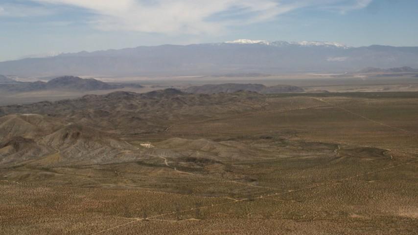 Pan across Iron Ridge in the Mojave Desert, San Bernardino County, California Aerial Stock Footage | FG0001_000105