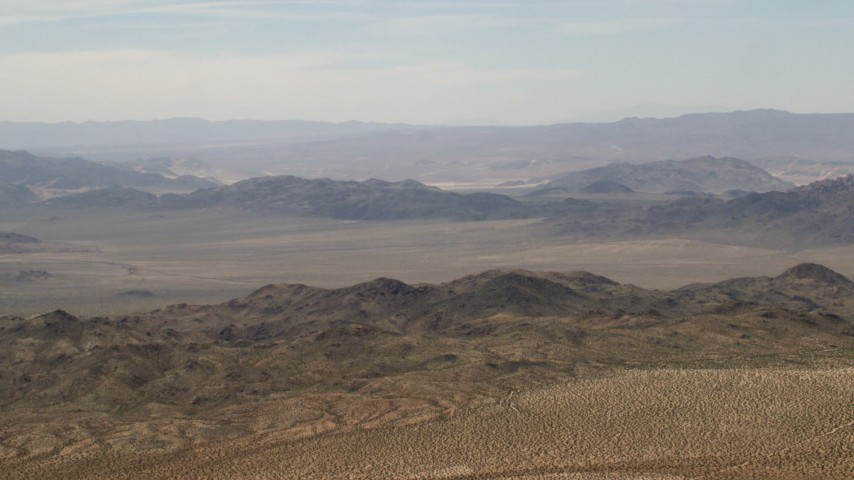 4K stock footage aerial video of passing Iron Ridge mountains and small ranges in the Mojave Desert, San Bernardino County, California Aerial Stock Footage | FG0001_000109