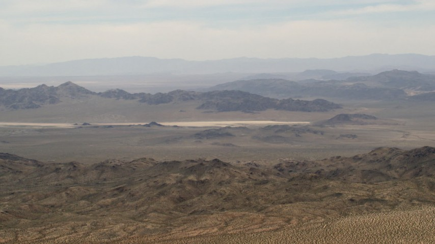 Iron Ridge mountains and desert ridges in the background in the Mojave Desert, San Bernardino County, California Aerial Stock Footage | FG0001_000111
