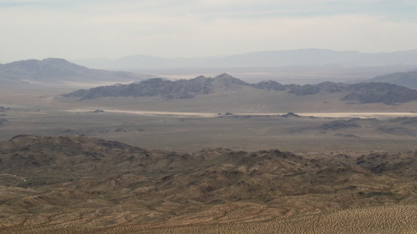 4K stock footage aerial video wide view of Iron Ridge mountains and distant desert ridges in the Mojave Desert, San Bernardino County, California Aerial Stock Footage | FG0001_000112