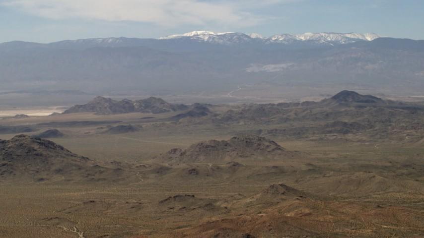 The San Bernardino Mountains behind Mojave Desert mountains, San Bernardino County, California Aerial Stock Footage | FG0001_000113