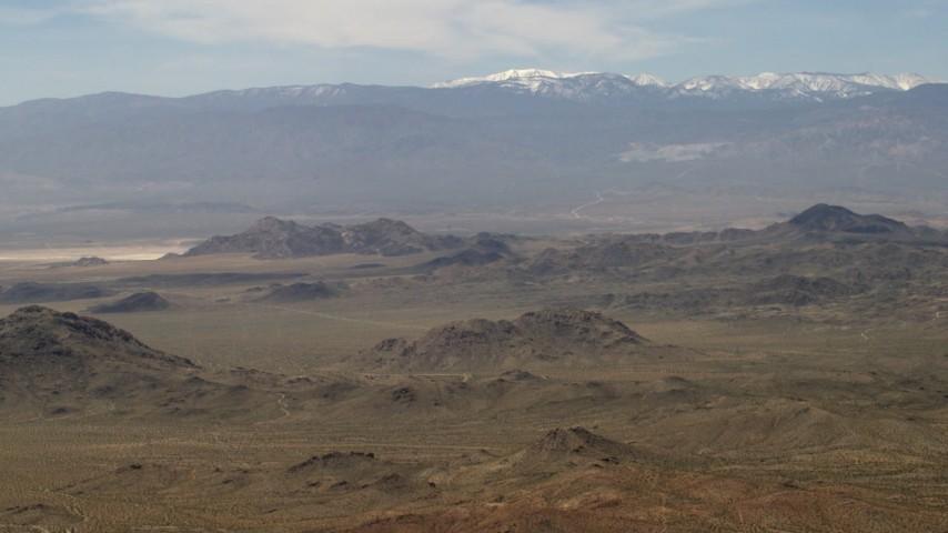 4K stock footage aerial video of the San Bernardino Mountains with snow behind Mojave Desert mountains, San Bernardino County, California Aerial Stock Footage | FG0001_000114