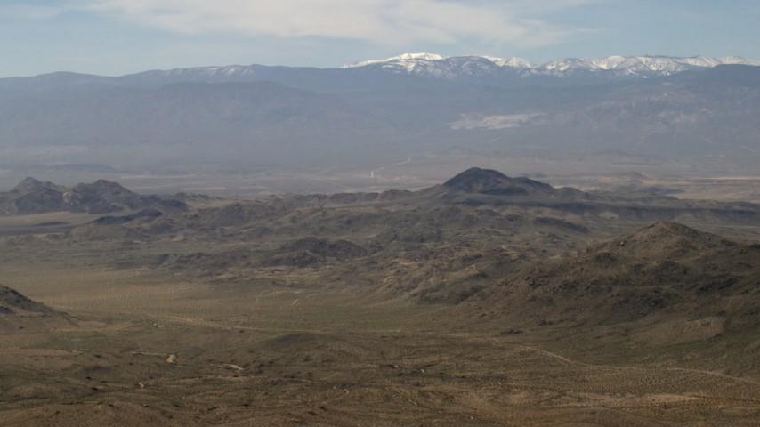 The snowy San Bernardino Mountains and Mojave Desert mountains, San Bernardino County, California Aerial Stock Footage | FG0001_000117