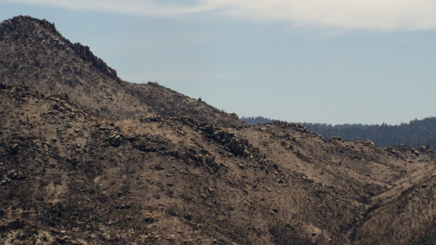 An arid mountain ridge in the Mojave Desert, San Bernardino County, California Aerial Stock Footage | FG0001_000125