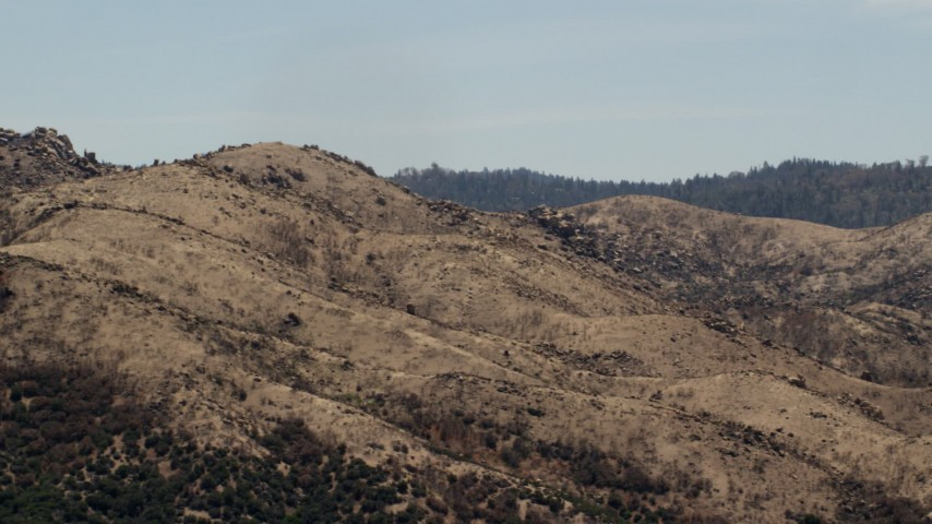 4K stock footage aerial video of a mountain ridge in the Mojave Desert, San Bernardino County, California Aerial Stock Footage | FG0001_000126