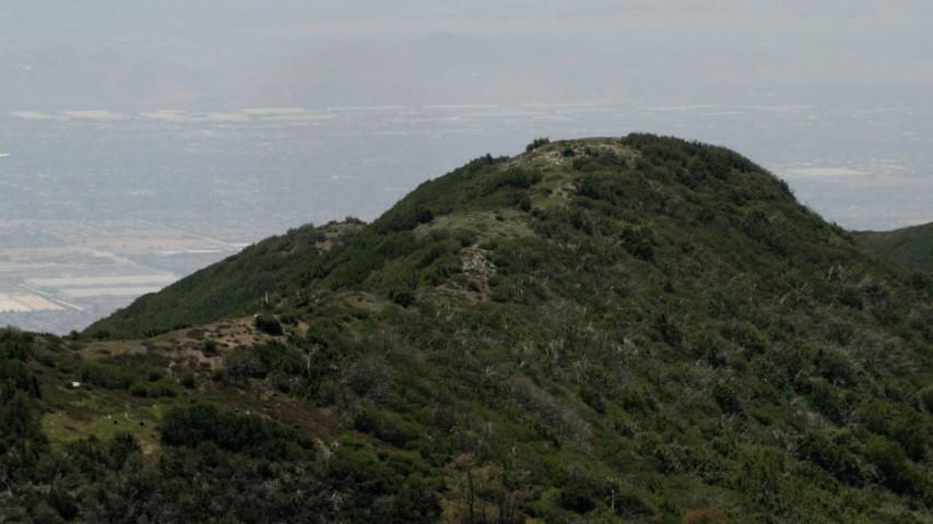 4K stock footage aerial video of passing a mountain ridge in the San Bernardino Mountains of California Aerial Stock Footage   FG0001_000133