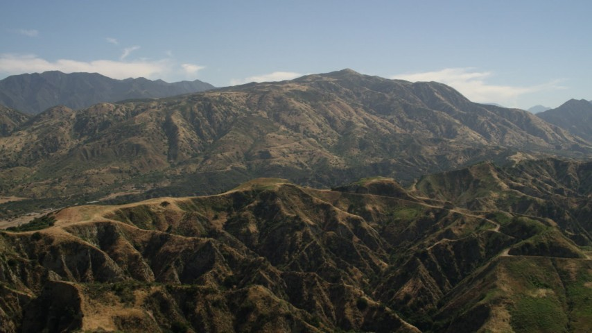 4K stock footage aerial video of a mountain ridge and tall peak in the San Gabriel Mountains, California Aerial Stock Footage | FG0001_000155