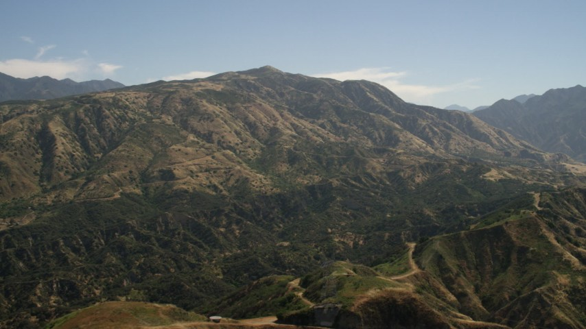 Pan across a mountain peak in the San Gabriel Mountains, California Aerial Stock Footage | FG0001_000156