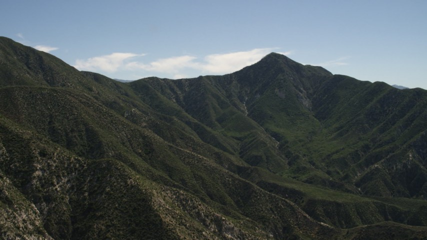 Pan across a green mountain ridge in the San Gabriel Mountains, California Aerial Stock Footage | FG0001_000157