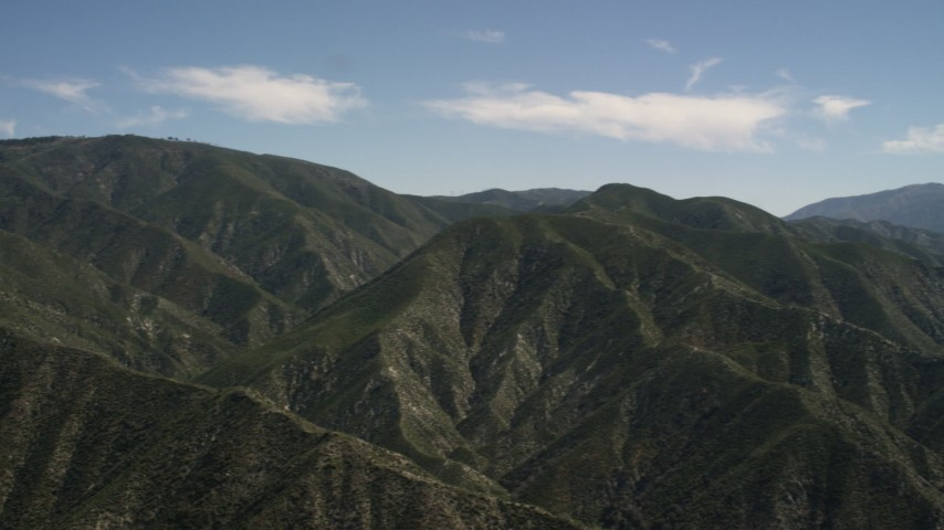 4K stock footage aerial video pan back and forth across green mountains in the San Gabriel Mountains, California Aerial Stock Footage | FG0001_000160