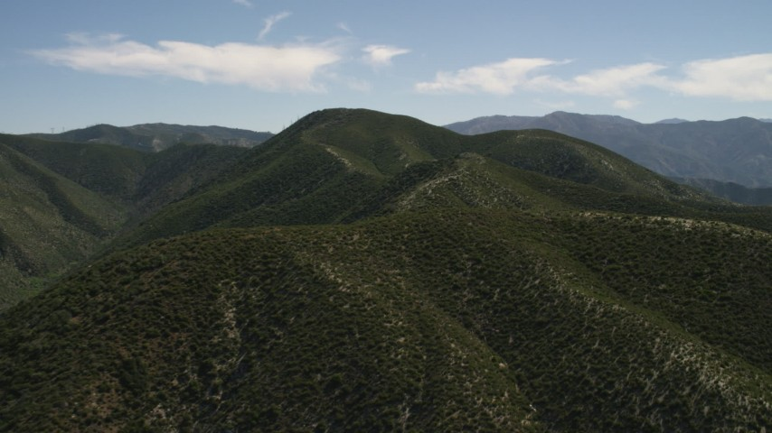 4K stock footage aerial video approach and fly over a green mountain ridge in the San Gabriel Mountains, California Aerial Stock Footage | FG0001_000163