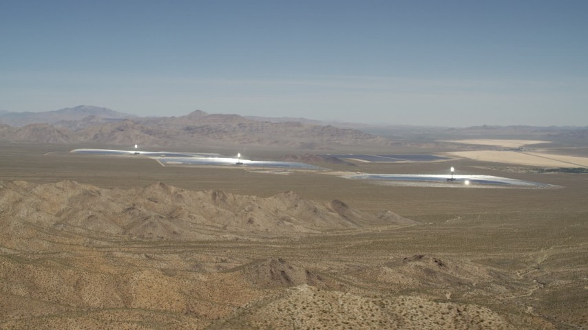 Tilt from blue skies to reveal the Ivanpah Solar Electric Generating System, California Aerial Stock Footage | FG0001_000167
