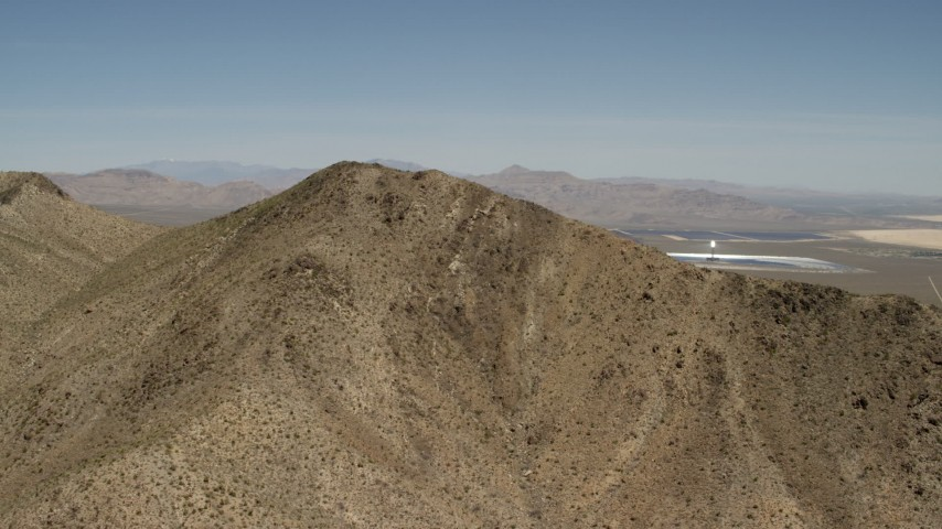 Approach desert mountain near the Ivanpah Solar Electric Generating System in California Aerial Stock Footage | FG0001_000170