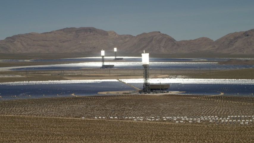 Power towers and mirrors of the Ivanpah Solar Electric Generating System in California Aerial Stock Footage | FG0001_000178