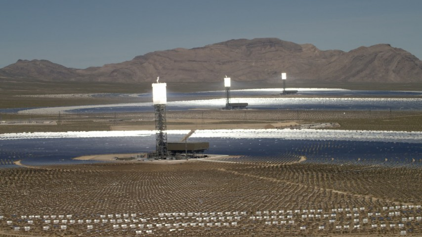 Three power towers and mirrors of the Ivanpah Solar Electric Generating System in California Aerial Stock Footage FG0001_000179