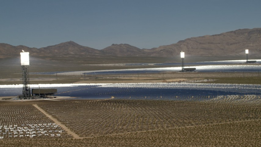 Row of power towers and mirrors of the Ivanpah Solar Electric Generating System in California Aerial Stock Footage FG0001_000180