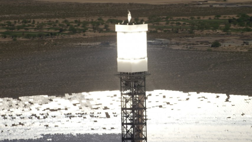 Orbit the top of a power tower at the Ivanpah Solar Electric Generating System in California Aerial Stock Footage | FG0001_000185