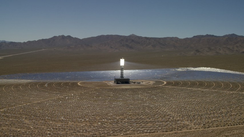 Circling around one of the arrays at the Ivanpah Solar Electric Generating System in California Aerial Stock Footage | FG0001_000191