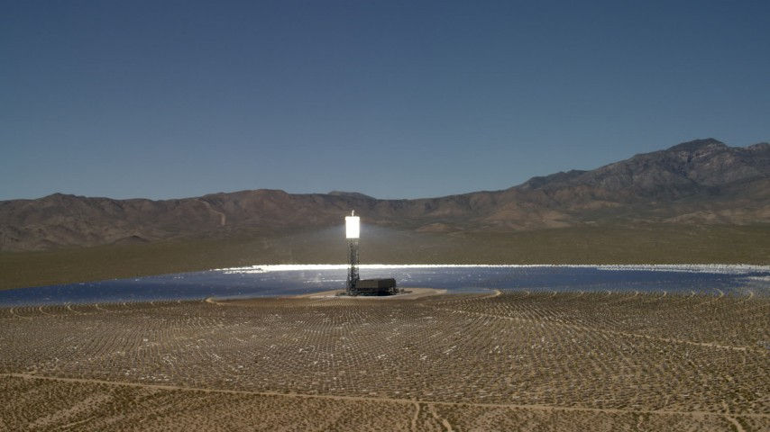 Tilt to reveal and orbit an array at the Ivanpah Solar Electric Generating System in California Aerial Stock Footage | FG0001_000193