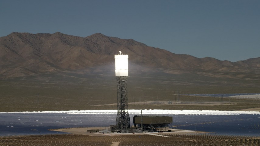 Orbit an array and reveal the others at the Ivanpah Solar Electric Generating System in California Aerial Stock Footage | FG0001_000195