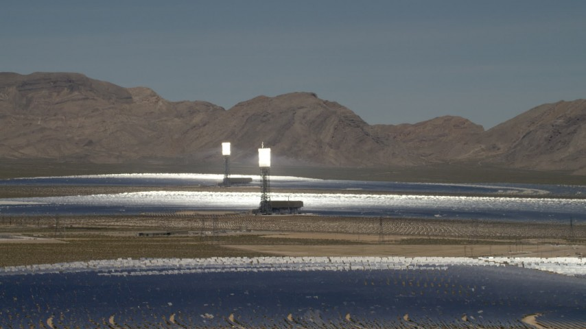 The desert arrays of the Ivanpah Solar Electric Generating System in California Aerial Stock Footage | FG0001_000197
