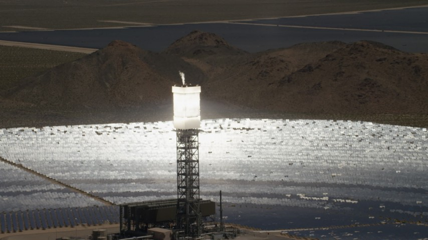 Zoom wider from a clope-up of a power tower boiler at the Ivanpah Solar Electric Generating System in California Aerial Stock Footage | FG0001_000203