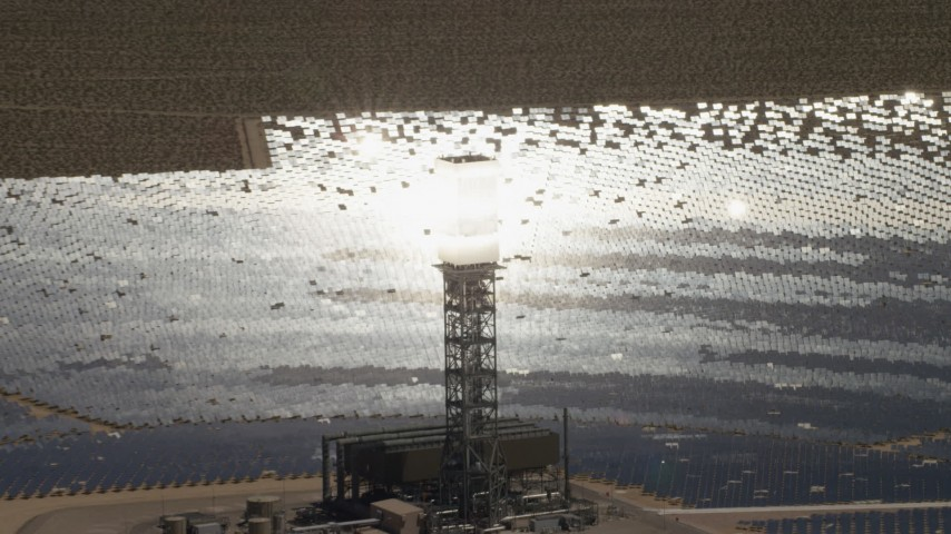Zoom tighter to a clope-up of a power tower boiler at the Ivanpah Solar Electric Generating System in California Aerial Stock Footage | FG0001_000204