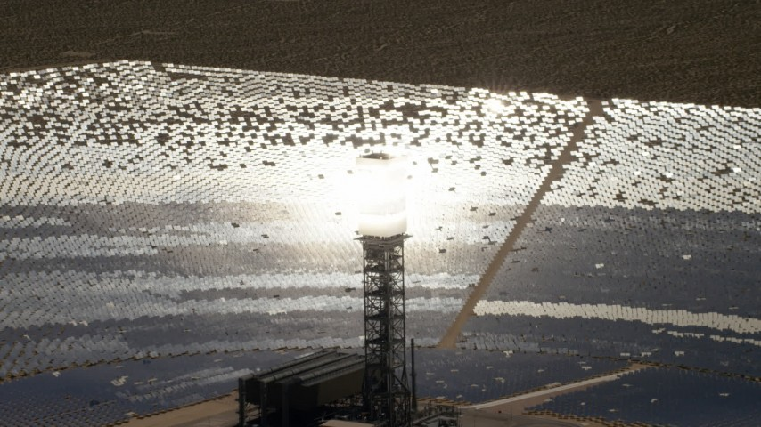 4K stock footage aerial video of glowing power tower boiler and mirrors at the Ivanpah Solar Electric Generating System in California Aerial Stock Footage | FG0001_000206